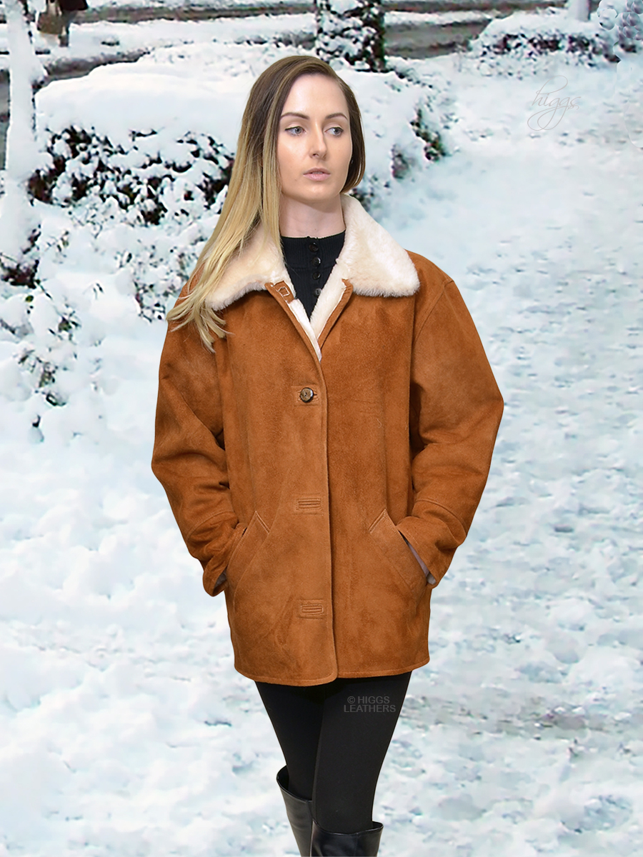 Higgs Leathers {34' to 46' bust}  Boxy (Tan with White Merino Shearling jacket) Casually classic Shearling jacket!